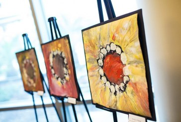Artist living with ALS debuts new exhibit of works created using her feet