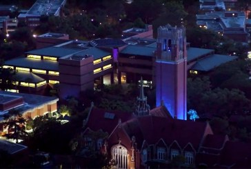 University of Florida's Century Tower bathed in blue to honor health care workers