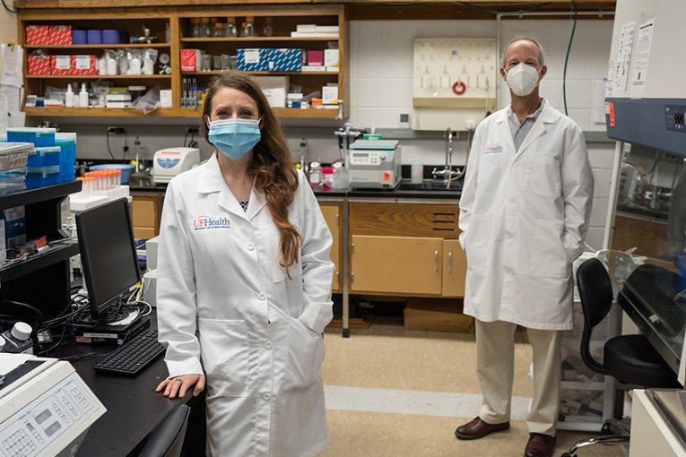 Dr. Leah Reznikov and Dr. David Ostrov are shown in Reznikov's lab. (Photo by Jesse Jones)